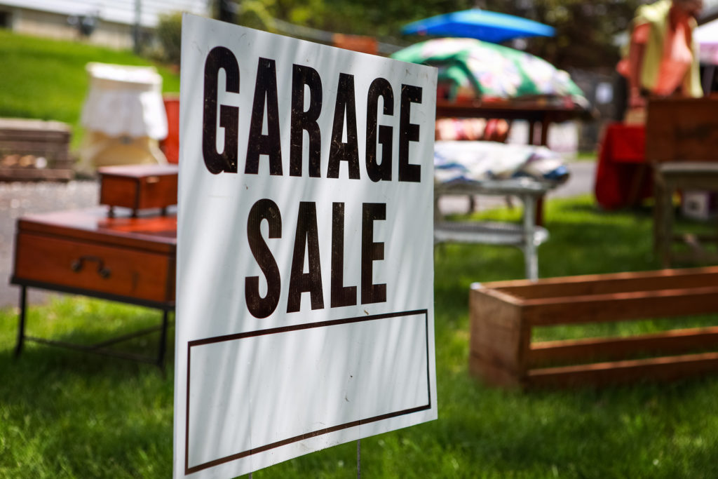 bigstock-Garage-sale-sign-on-the-shady-187823692-1024x683